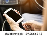 charge mobile in car. | Shutterstock . vector #691666348