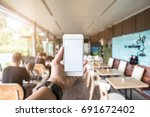 hands of man using phone white... | Shutterstock . vector #691672402