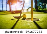 mini golf yellow ball with a... | Shutterstock . vector #691677298
