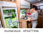 Woman Cooking In Camper ...