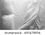 messy double bed. two pillows... | Shutterstock . vector #691678456