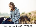 young asia woman writing into...   Shutterstock . vector #691678822