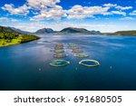 farm salmon fishing in norway | Shutterstock . vector #691680505