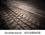 dirt wheel track on earth | Shutterstock . vector #691688608