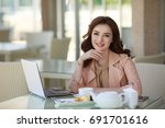 successful business woman with... | Shutterstock . vector #691701616