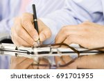 businessman taking notes during ... | Shutterstock . vector #691701955