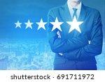 businessman look at five star... | Shutterstock . vector #691711972