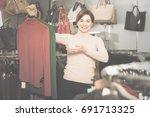 brunette young woman enjoying... | Shutterstock . vector #691713325
