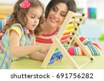 young mother playing with... | Shutterstock . vector #691756282