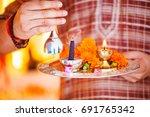 hindu ceremony. puja   offering ... | Shutterstock . vector #691765342