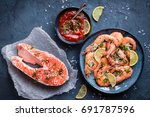 salmon and shrimps on plate... | Shutterstock . vector #691787596