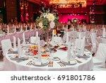 long festive table served... | Shutterstock . vector #691801786