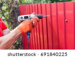 metal fence installation. work... | Shutterstock . vector #691840225
