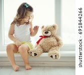 cute baby at home in white room ... | Shutterstock . vector #691844266