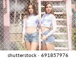 two beautiful fashionable... | Shutterstock . vector #691857976