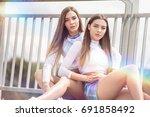 twins sisters having fun...   Shutterstock . vector #691858492