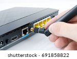 man connecting antenna to wi fi ...   Shutterstock . vector #691858822