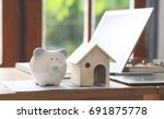piggy bank and house design on...   Shutterstock . vector #691875778