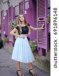 beautiful girl in colored skirt ...   Shutterstock . vector #691896148