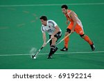 BLOEMFONTEIN, SOUTH AFRICA - JANUARY 16: Unidentified players during a men's field hockey game between Germany and Netherlands (Netherlands won 2-1) on January 16, 2010 in Bloemfontein, South Africa. - stock photo