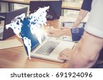 Small photo of Sending email, gesture of finger pressing send button on a computer keyboard on world map with people in office, communication concept, Elements of this image furnished by NASA.