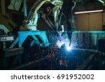team robot welding movement... | Shutterstock . vector #691952002