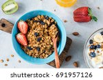 granola bowl with dried raisins ... | Shutterstock . vector #691957126