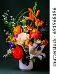a vase of pseudo rose and lily... | Shutterstock . vector #691968196