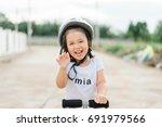 asian smiling little girl... | Shutterstock . vector #691979566