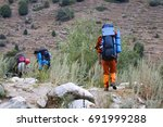 hiking in the mountains of... | Shutterstock . vector #691999288