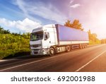 big white truck on the road in... | Shutterstock . vector #692001988