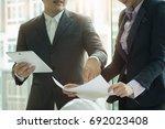interior designer team planning ... | Shutterstock . vector #692023408