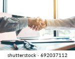 business people accept or... | Shutterstock . vector #692037112
