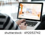 hand tying labtop computer with ... | Shutterstock . vector #692052742
