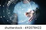 businessman touching global... | Shutterstock . vector #692078422