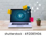 business people use technology... | Shutterstock . vector #692085406
