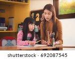 teacher and student take home...   Shutterstock . vector #692087545
