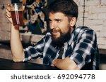 a man with a beard holds a... | Shutterstock . vector #692094778
