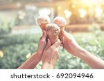 young woman hands holding ice... | Shutterstock . vector #692094946