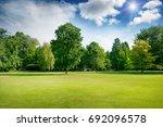 bright summer sunny day in park ... | Shutterstock . vector #692096578