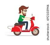 funny bearded guy riding red... | Shutterstock .eps vector #692103946