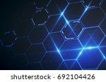 abstract glowing blue hexagonal ... | Shutterstock . vector #692104426