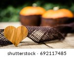 Pumpkins With Jute On Wooden...