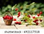 Many Fresh Rose Hips On A Tabl...