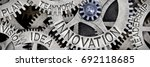 Small photo of Macro photo of tooth wheel mechanism with INNOVATION, LEADERSHIP, TEAMWORK, IDEA, VISION, PLAN concept letters