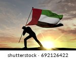 united arab emirates flag being ... | Shutterstock . vector #692126422