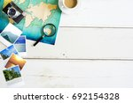 travel desk with folded paper... | Shutterstock . vector #692154328
