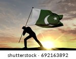 pakistan flag being pushed into ... | Shutterstock . vector #692163892