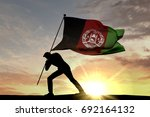 afghanistan flag being pushed... | Shutterstock . vector #692164132