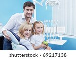 Families with a child in the dental office - stock photo
